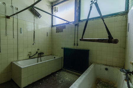 bathtubs with handhold in an abandoned hospital