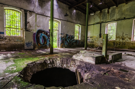 big hole in the ceiling of abandoned factory Stock Photo