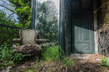 mirror with armchair in an old villa