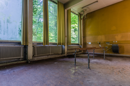 railings for walking exercise in an abandoned rehab center Stock Photo