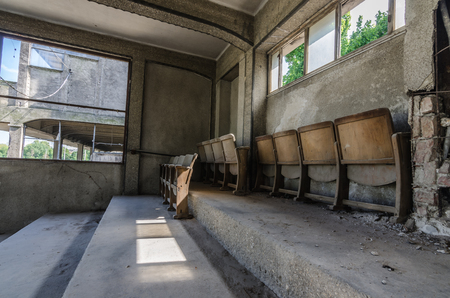 wooden seats on abandoned old trotting course Stock Photo
