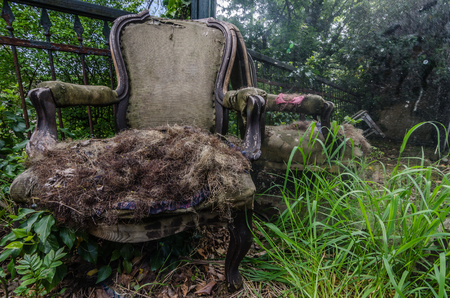 torn armchair in an old villa