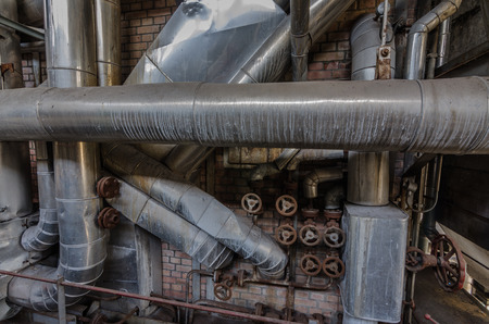 many pipes and valves in boiler room Stock Photo