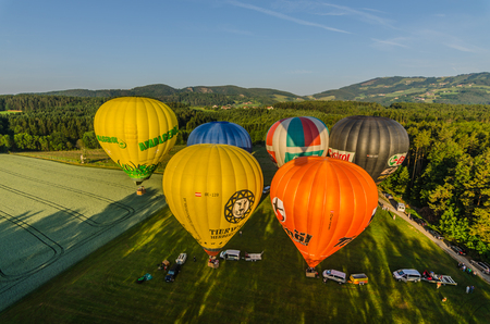 many colorful hot air balloons on the ground before taking off