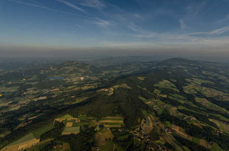 mountains forests and fields from above at a ballooning Stock Photo