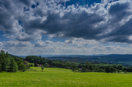 beautiful green landscape with clouds in the sky