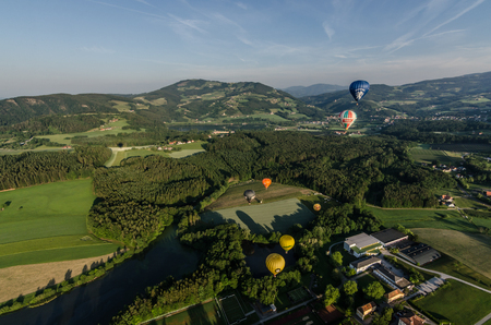 many hot air balloons in the landscape Stock Photo