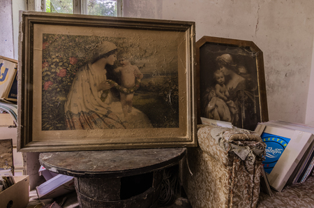 beautiful old pictures in an old abandoned house