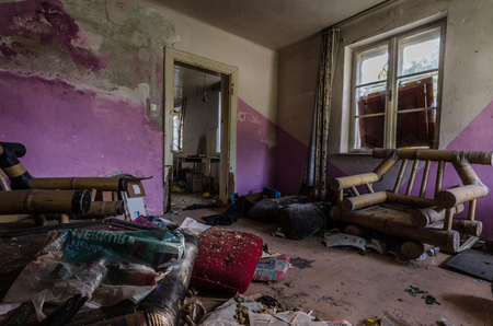 purple room in an abandoned house Stock Photo