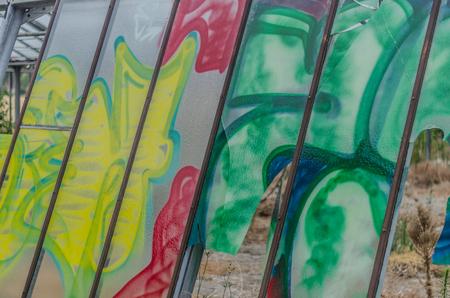 Graffiti on a deserted glasshouse