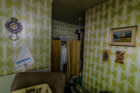 Room with green wallpaper in a house
