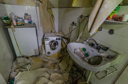 Devastated bathroom in an abandoned house Editorial
