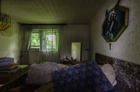 Bedroom with picture in an old abandoned house
