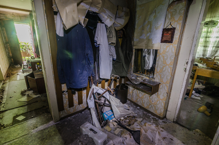 Objects in a wardrobe in abandoned house