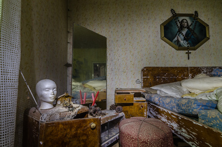 white head in a bedroom of abandoned house