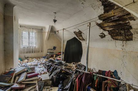 abandoned attic and many clothes