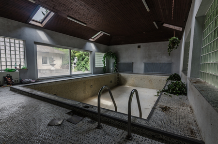 abandoned swimming pool in old house