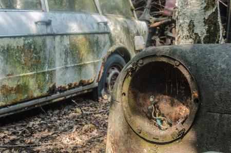Light from rusty car on a junkyard Imagens