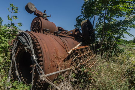 overgrown steam boiler in nature 스톡 콘텐츠
