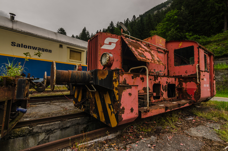 red locomotive on an old train station