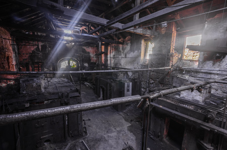 dark foundry with sunlight from outside