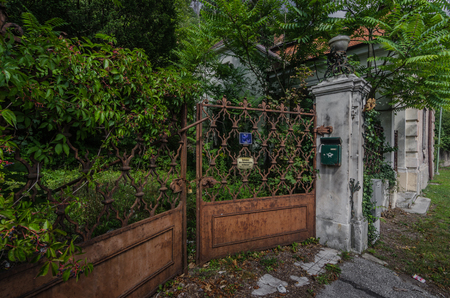 fused entrance gate of an old villa Editorial