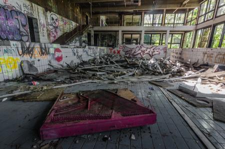 Old abandoned indoor pool with graffiti Reklamní fotografie