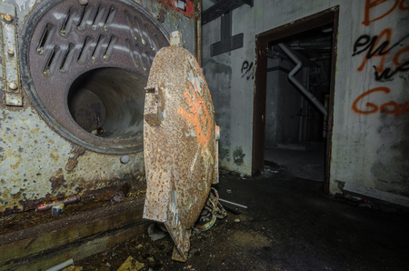 Old rusty stove in an abandoned factory