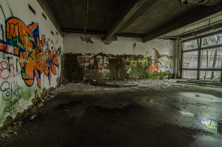 Colorful graffiti in abandoned room of a building Stock Photo