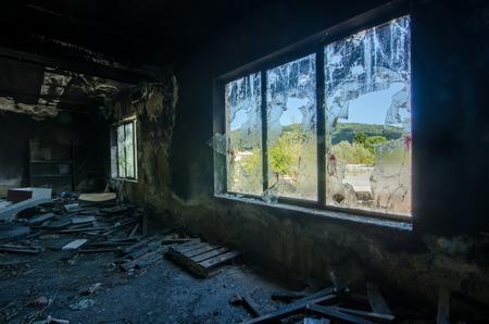 Broken window of an abandoned factory