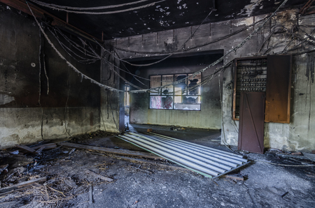 hanging pipes in a burned factory room