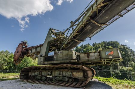 Wide angle view of a bucket wheel excavator in the mountains