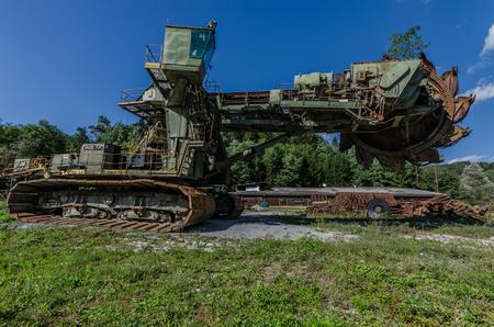abandoned bucket wheel excavator on a parking lot Imagens