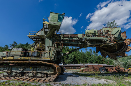 Big old shovel wheel excavator in the mountains