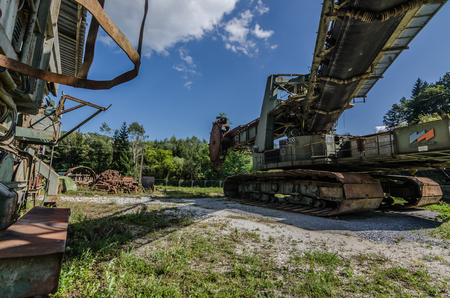 rusty abandoned machinery on a terrain Imagens