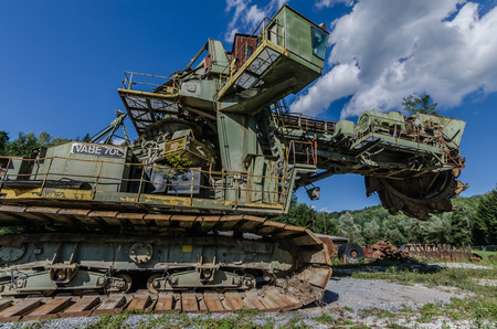 old bucket wheel excavator with sky and clouds