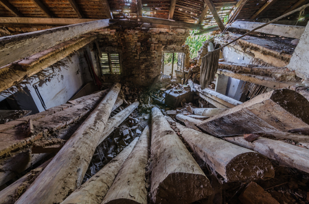 heavy collapsed wooden ceiling of a forest house