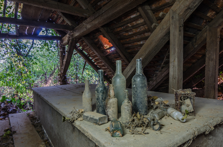 different bottles in old abandoned house