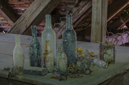 different old bottles in an old house
