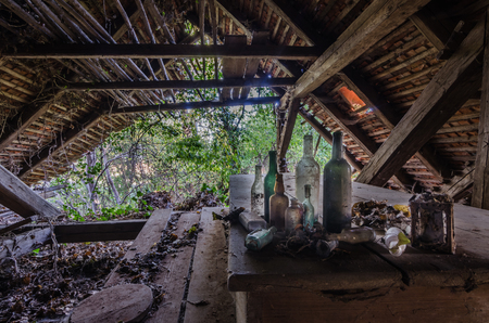 Colorful bottles in abandoned attic of old house Banco de Imagens