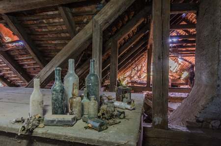 different bottles in a loft of a forest house