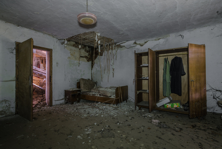 room and bed in old abandoned house