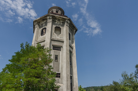 abandoned old concrete tower on a terrain
