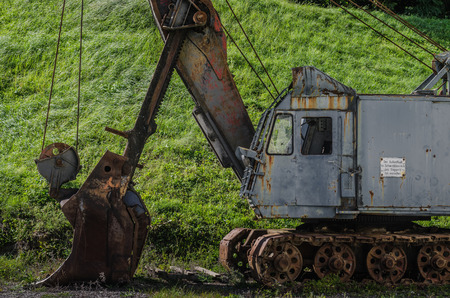 abandoned old rusty excavator in nature