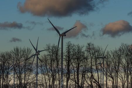 windmills trees and clouds in the sky Banque d'images