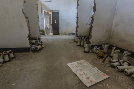 abandoned switchover and isolators on the ground Stockfoto