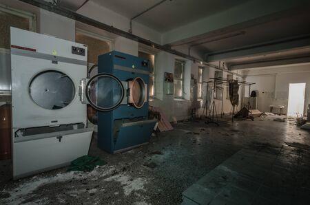 big washing machines in abandoned hospital