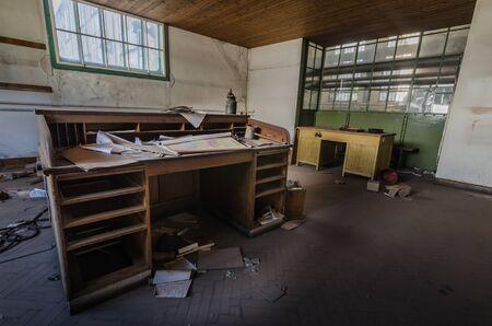 desk in big abandoned factory Stockfoto