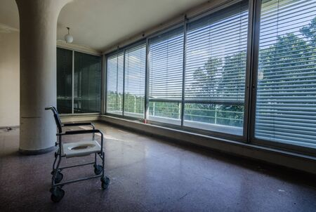 physical chair and round pillar with many windows in a hospital in the forest