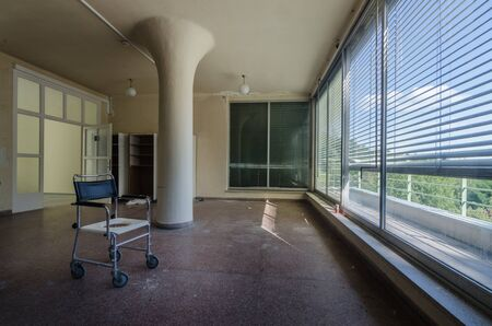 physical chair and round pillar in a hospital in the forest